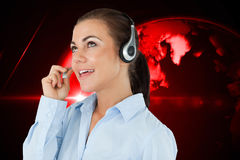 Composite image of call center agent looking upwards while talking Royalty Free Stock Photography