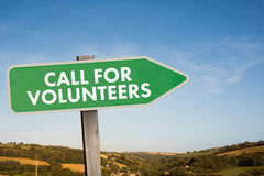 Composite image of call for volunteers. Call for volunteers against blue sky over fields Royalty Free Stock Images