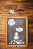 Composite image of call for volunteers. Call for volunteers against hipsters desk Stock Photos