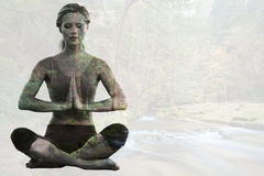 Composite image of calm blonde sitting in lotus pose with hands together Royalty Free Stock Images