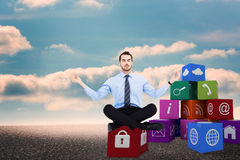 Composite image of calm businessman sitting in lotus pose Royalty Free Stock Images