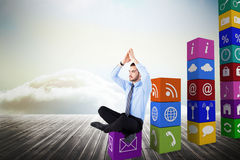 Composite image of calm businessman sitting in lotus pose with hands together Stock Photo