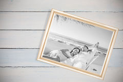 Composite image of calm couple napping in a hammock Royalty Free Stock Images