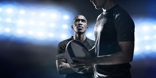 Composite image of calm rugby player thinking while holding ball Stock Photography