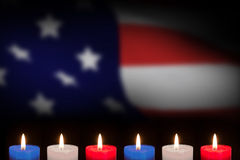 Composite image of candles on black background Stock Images