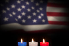 Composite image of candles on black background Stock Photos