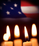 Composite image of candles in the dark Stock Photo