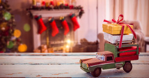 Composite image of car toy on wooden surface Royalty Free Stock Photography