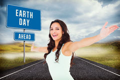 Composite image of carefree brunette with arms out Royalty Free Stock Images