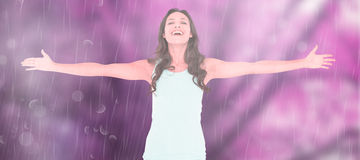 Composite image of carefree brunette with arms out Stock Image
