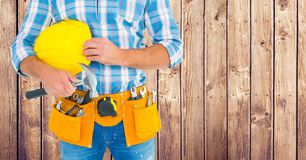 Composite image of Carpenter with hammer against wood panel Royalty Free Stock Photography