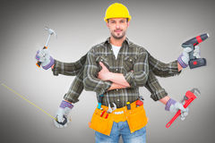 Composite image of carpenter with many arms Royalty Free Stock Photo