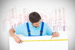 Composite image of carpenter measuring blank bill board. Carpenter measuring blank bill board against grey Royalty Free Stock Photos
