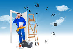Composite image of carpenter on the phone. Carpenter on the phone  against clock counting down to midnight Stock Image