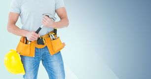 Composite image of Carpenter torso with hammer against blue background Stock Images