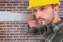 Composite image of carpenter using spirit level Royalty Free Stock Photography