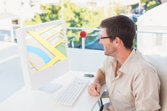 Composite image of casual businessman using computer Stock Photography