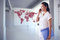 Composite image of casual businesswoman on the phone holding folder Stock Photos
