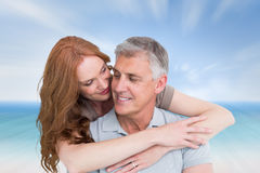 Composite image of casual couple hugging and smiling Stock Photography