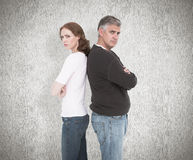 Composite image of casual couple not speaking after fight Royalty Free Stock Photography