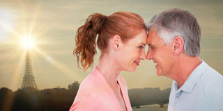Composite image of casual couple smiling at each other Stock Photo