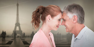 Composite image of casual couple smiling at each other Stock Photos