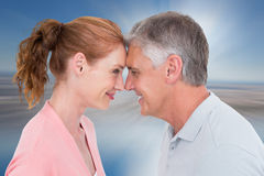 Composite image of casual couple smiling at each other Stock Images