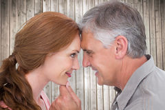 Composite image of casual couple smiling at each other Royalty Free Stock Photos