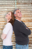Composite image of casual couple smiling and looking up Stock Images