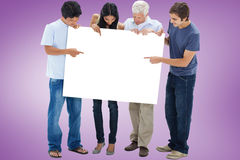 Composite image of casual group showing card Stock Photography