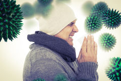 Composite image of casual man about to sneeze. Casual man about to sneeze against virus stock photo