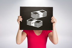 Composite image of casual woman showing board Stock Photo