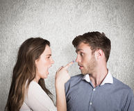 Composite image of casual young couple in an argument Stock Photos