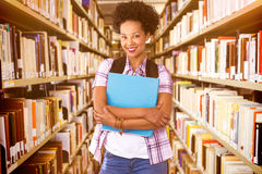 Composite image of casual young woman with folder in office Royalty Free Stock Photography