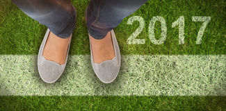 Composite image of casually dressed womans feet Royalty Free Stock Photography