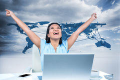 Composite image of celebrating woman with arms raised Stock Photography