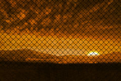 Composite image of chainlink fence against  white background. Chainlink fence against  white background against beautiful african scene Stock Photo