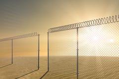 Composite image of chainlink fence against white background 3d. Chainlink fence against white background against desert scene 3d Stock Images