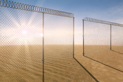 Composite image of chainlink fence against white background. Chainlink fence against white background against desert scene Royalty Free Stock Photography