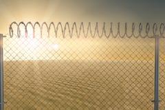 Composite image of chainlink fence against  white background. Chainlink fence against  white background against desert scene Stock Image
