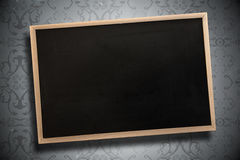 Composite image of chalkboard with wooden frame Stock Photo
