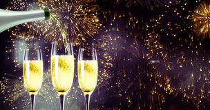 Composite image of champagne pouring Royalty Free Stock Photo