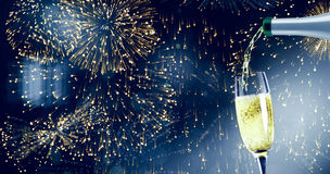 Composite image of champagne pouring Royalty Free Stock Photos