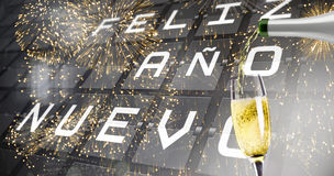Composite image of champagne pouring Stock Images