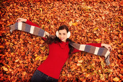 Composite image of cheerful brunette holding scarf and spread her arms Stock Photography