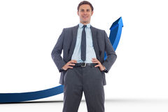 Composite image of cheerful businessman with hands on hips Royalty Free Stock Photography