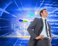 Composite image of cheerful businessman with hands on hips Royalty Free Stock Photos