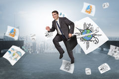 Composite image of cheerful businessman in a hurry Royalty Free Stock Photos