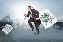 Composite image of cheerful businessman in a hurry Royalty Free Stock Image