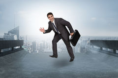 Composite image of cheerful businessman in a hurry Stock Images